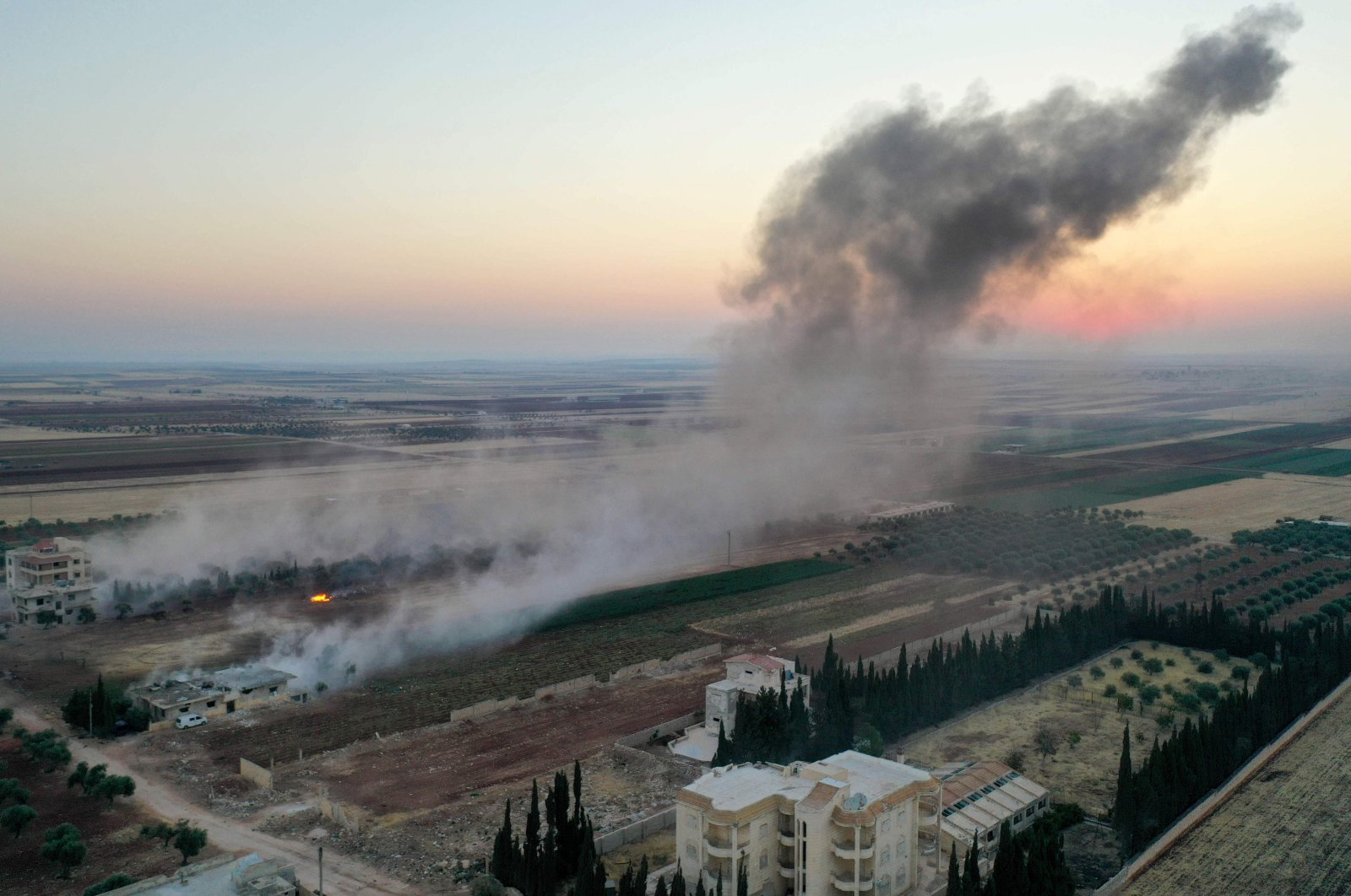 Smoke billows following airstrikes and shellings on the town of Binnish in opposition-controlled Idlib province, northwestern Syria, Aug. 3, 2020. (AFP Photo)