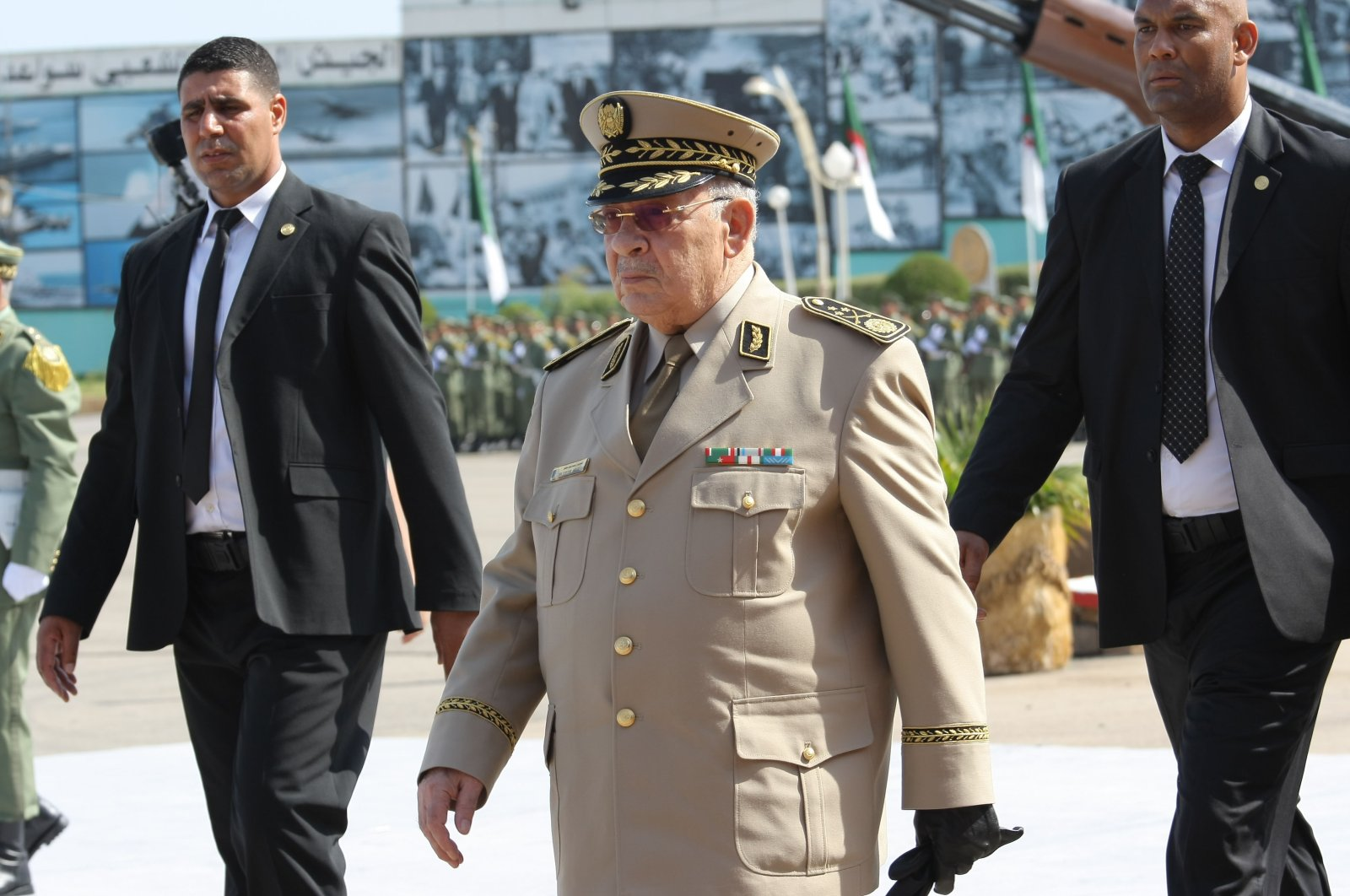 """Former Algerian Chief of Staff Gen. Ahmed Gaid Salah arrives to preside over a military parade at the Cherchell """"Houari Boumediene"""" in Algiers, Algeria, July 1, 2018. (AP Photo)"""