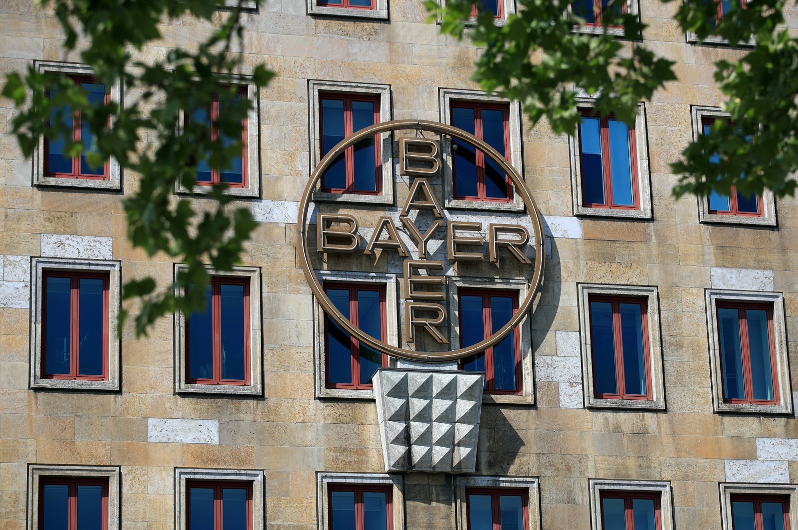 The logo of Bayer AG is pictured at the facade of the historic headquarters of the German pharmaceutical and chemical maker in Leverkusen, Germany, April 27, 2020. (Reuters Photo)