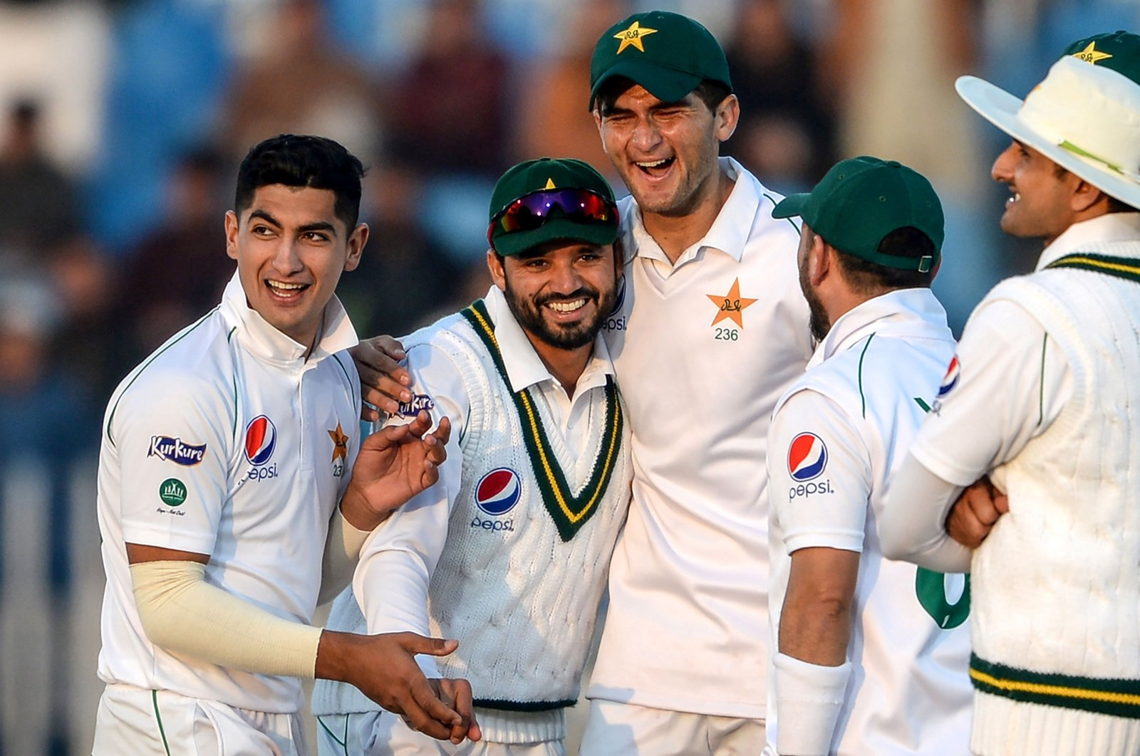 Pakistan's Naseem Shah (2nd L) celebrates with teammates Azhar Ali (L) and Shaheen Shah Afridi (C) after the dismissal of Bangladesh's Mohammad Mithun (unseen) during the first day of the first cricket Test match between Pakistan and Bangladesh at the Rawalpindi Cricket Stadium in Rawalpindi, Pakistan, Feb. 7, 2020.