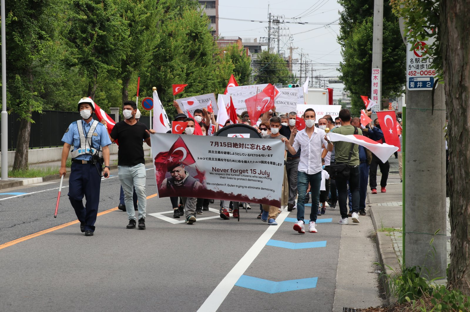 People demonstrate in front of the Enishi International School (EIS), which is linked to the Gülenist Terror Group (FETÖ), in central Nagoya, Japan, Aug. 4, 2020. (AA Photo)