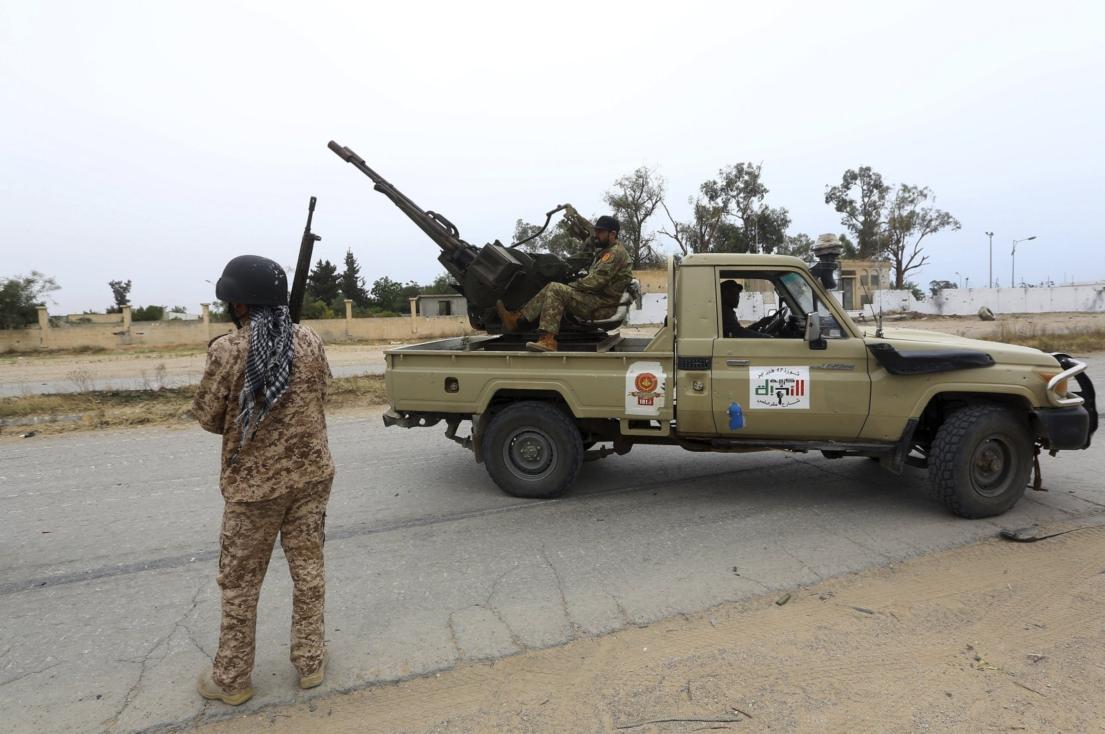Tripoli-based legitimate government forces are seen during clashes with illegitimate forces led by putschist Gen. Khalifa Haftar, south of the capital Tripoli, Libya, May 21, 2019. (AP Photo)