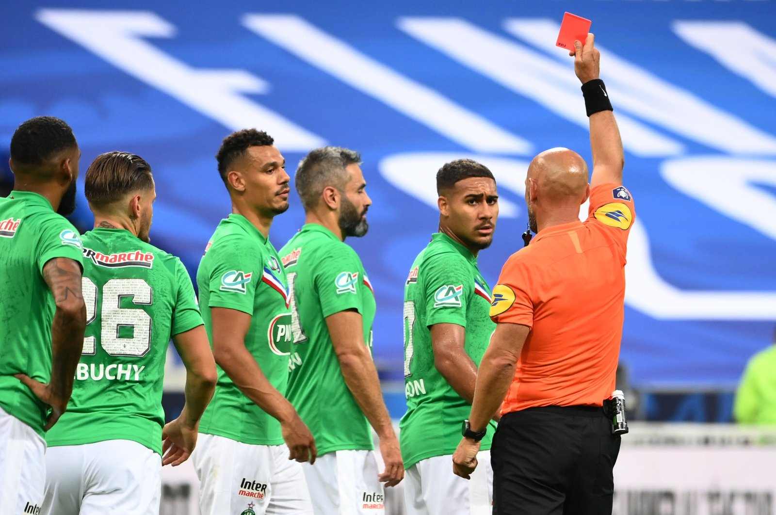 Saint-Etienne's French defender Loic Perrin (C) receives a red card from French referee Amaury Delerue (R) during the French Cup final football match between Paris Saint-Germain (PSG) and Saint-Etienne (ASSE) at the Stade de France in Saint-Denis, outside Paris, France on July 24, 2020. (AFP Photo)