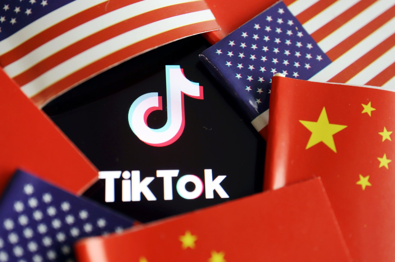This illustration shows the Chinese and U.S. flags near a TikTok logo. (Reuters Photo)