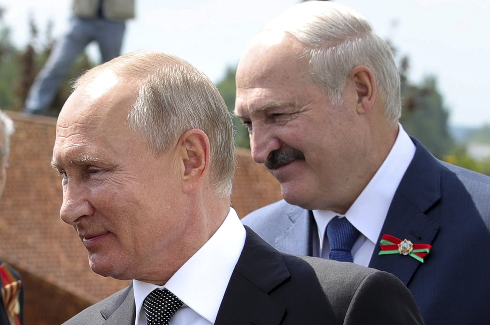 In this June 30, 2020 file photo, Russian President Vladimir Putin (L) and Belarusian President Alexander Lukashenko greet World War II veterans during an opening ceremony of the monument in honor of the World War II Red Army, in the village of Khoroshevo, Russia. (AP Photo)