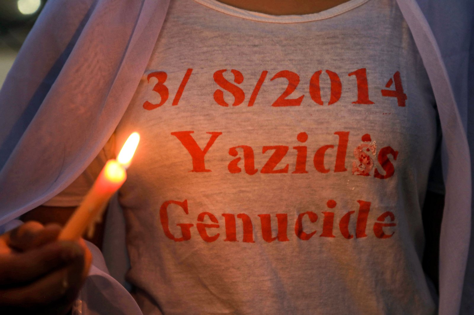 Iraqi Yazidis attend a candle-lit vigil in the Sharya area, some 15 km (9 miles) from the northern city of Dohuk in the autonomous Iraqi Kurdistan Regional Government (KRG) region, marking the sixth anniversary of the Daesh attack on the Yazidi community in the northwestern Sinjar district of Iraq, Aug. 3, 2020. (AFP Photo)