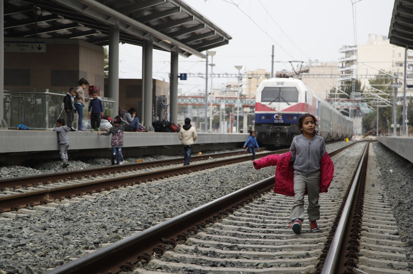 A migrant boy walks on a rail track at the Larissis Station in Athens, Greece, April 5, 2019. (AP Photo)