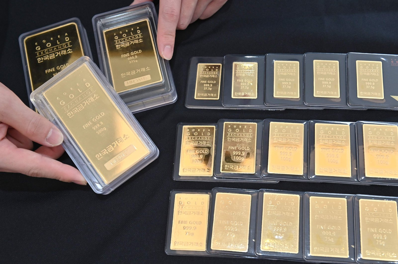 An employee displays gold bars at a Korea Gold Exchange shop in Seoul, South Korea on July 30, 2020. (AFP Photo)