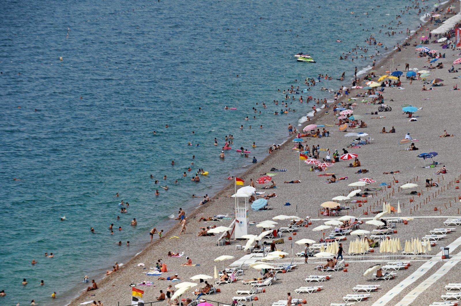 People are seen on a beach in the Mediterranean resort city of Antalya, Turkey, Aug. 4, 2020. (IHA Photo)
