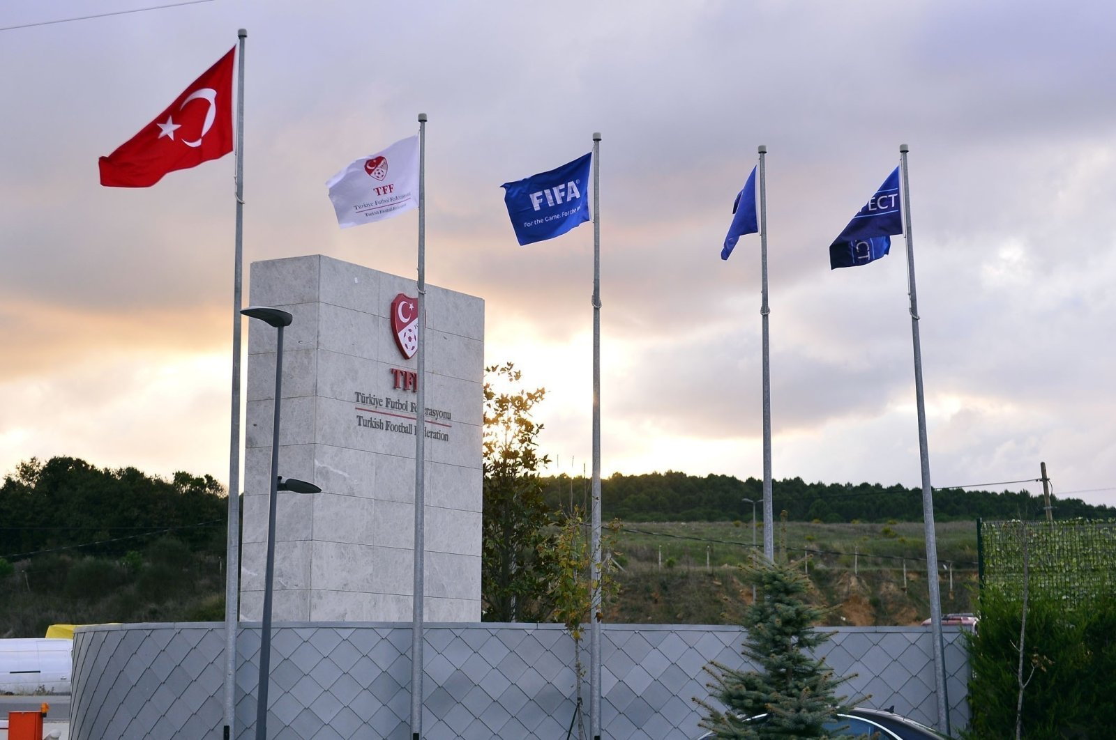 Flags wave against the backdrop of the logo of the Turkish Football Federation, in Istanbul, Turkey, Aug. 2, 2020. (IHA Photo)