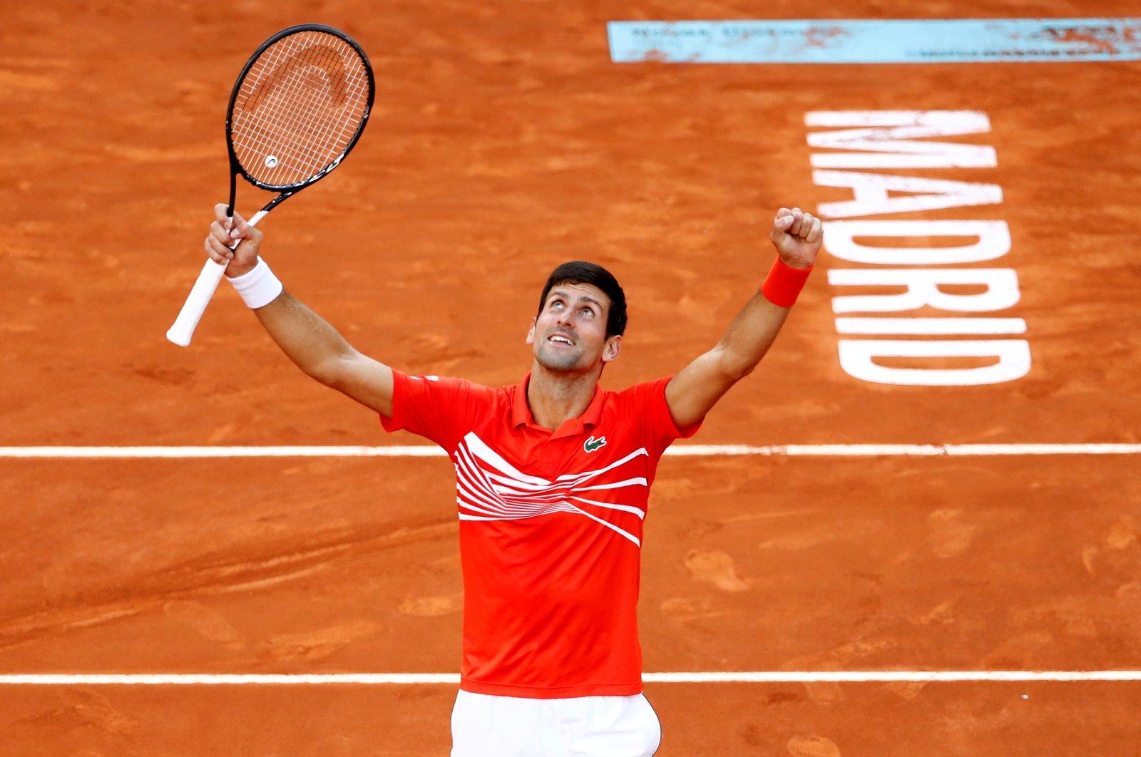 Serbia's Novak Djokovic celebrates winning the Madrid Open tennis tournament in Madrid, Spain, May 12, 2019. (Reuters Photo)