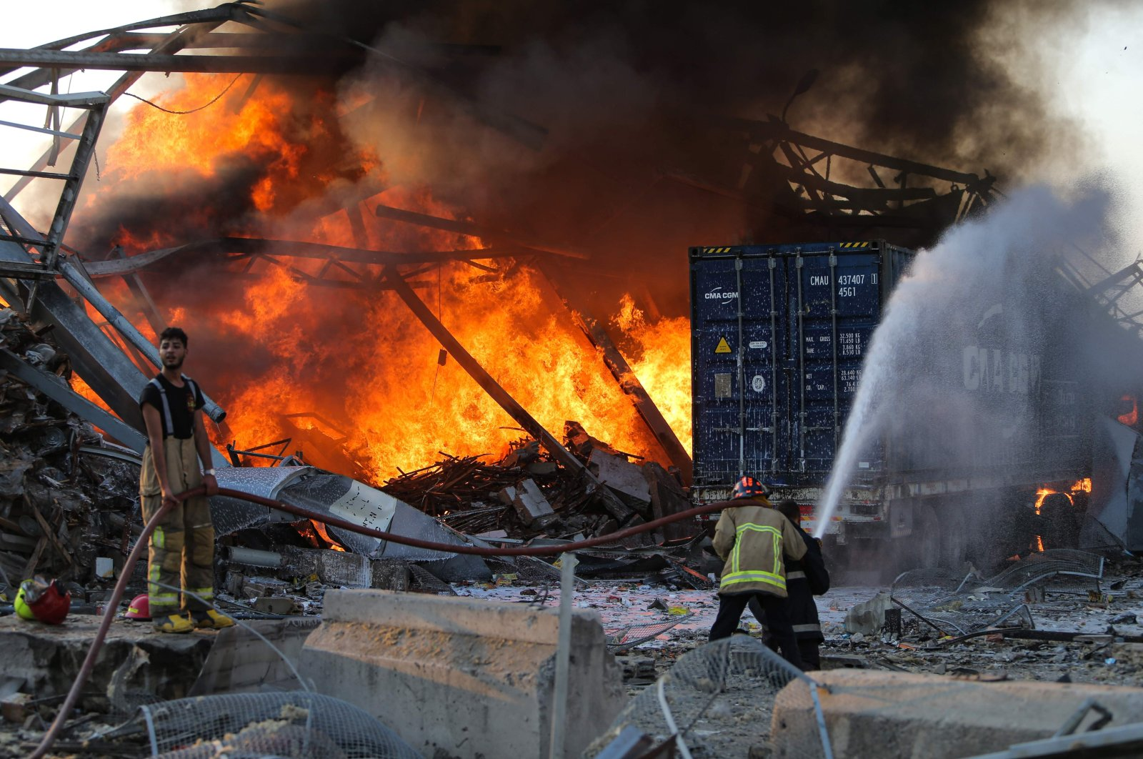 Firefighters douse a blaze at the scene of an explosion at the port of Lebanon's capital Beirut, Aug. 4, 2020. (AFP)