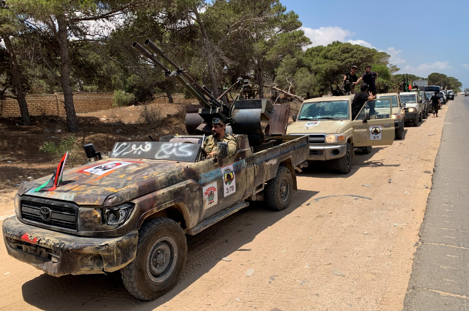 Troops loyal to Libya's internationally recognized government are seen in military vehicles as they prepare in the capital Tripoli before heading to Sirte, Libya, July 6, 2020. (Reuters Photo)
