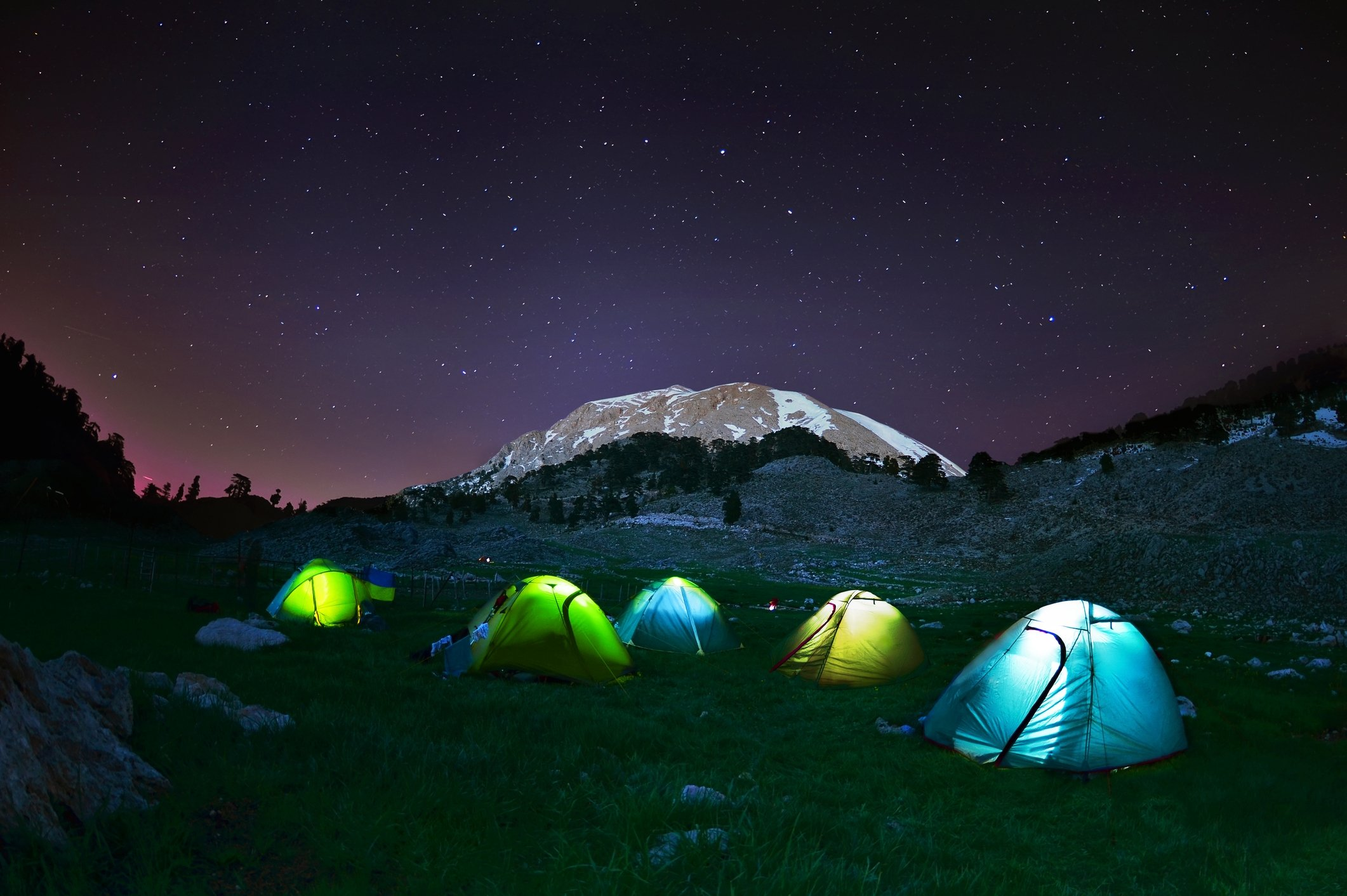 Away from the city lights, camping under the starry night sky is a great way to escape the stress of daily life. (iStock Photo)