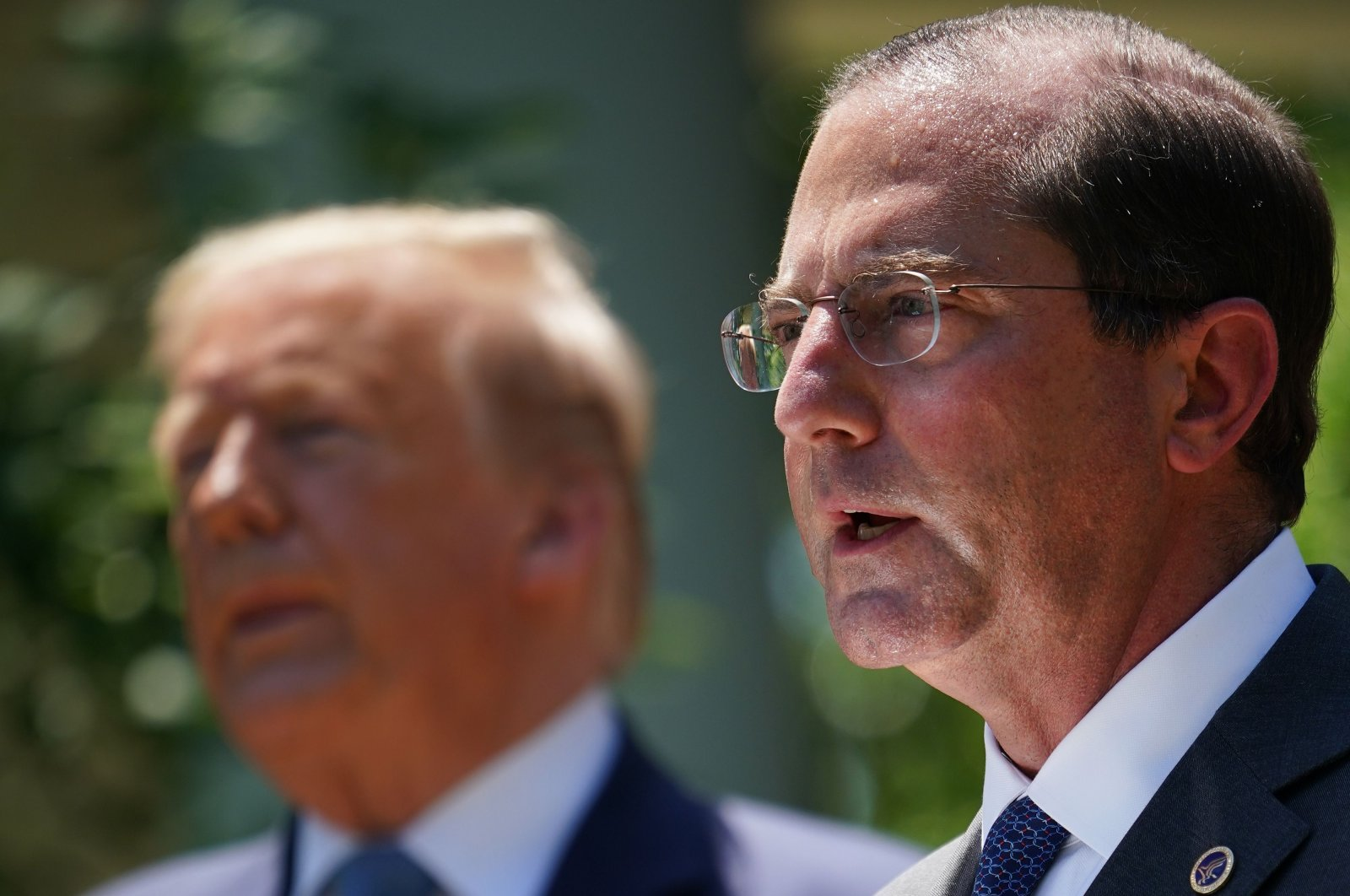 U.S. Secretary of Health and Human Services Alex Azar (R) speaks as U.S. President Donald Trump (L) looks on, in the Rose Garden of the White House in Washington, D.C., U.S., May 15, 2020. (AFP Photo)