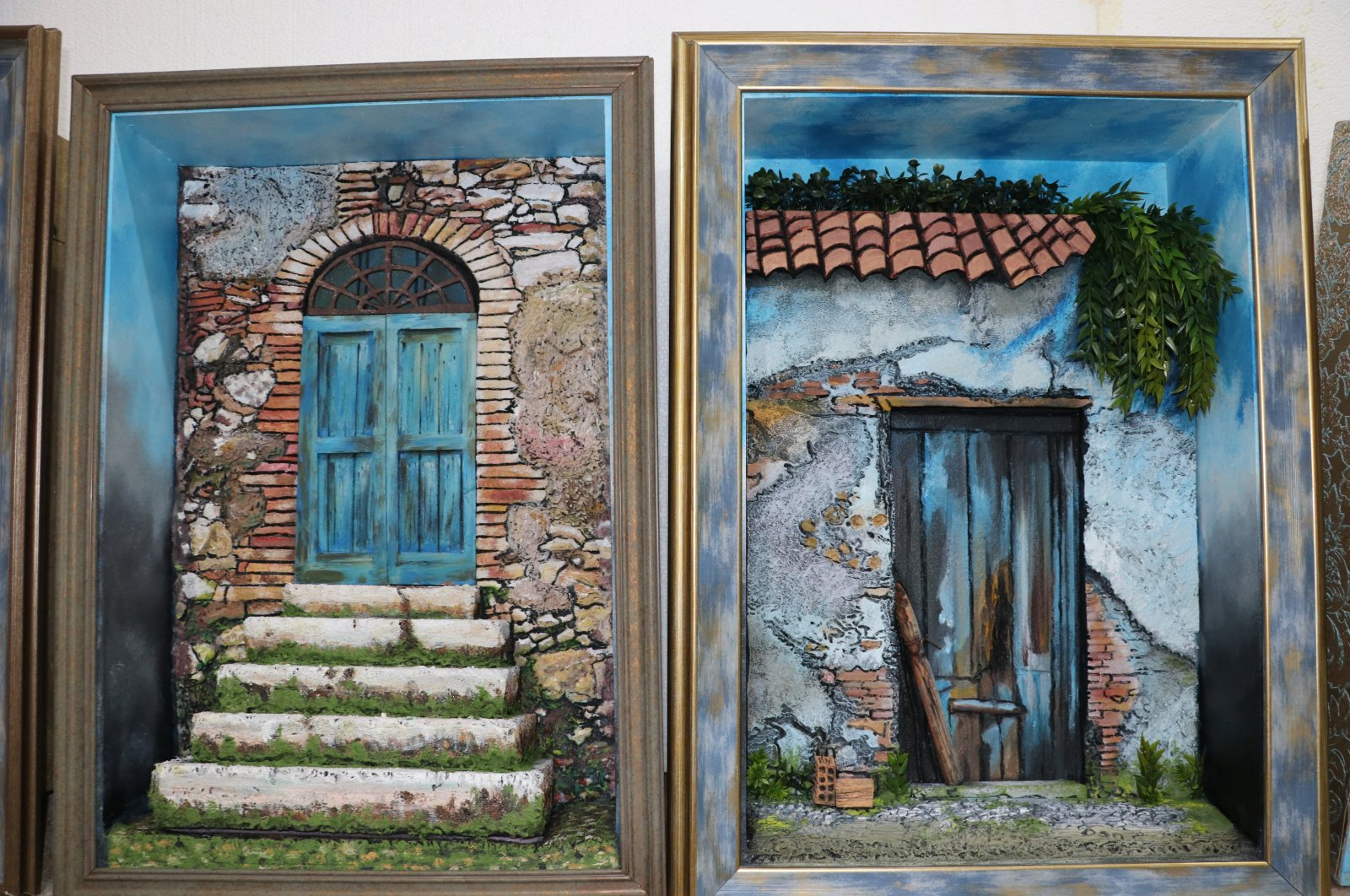 Two works depicting old Mersin houses that were made with a relief technique, Aug. 4, 2020. (AA PHOTO)