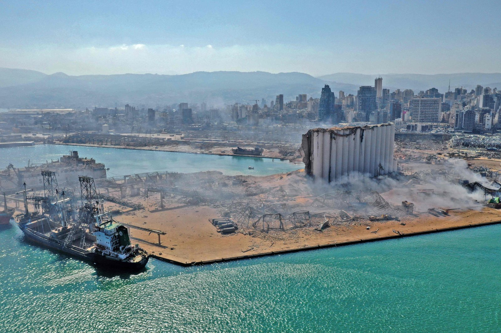 An aerial view shows the massive damage done to Beirut port's grain silos (C) and the area around it one day after a mega-blast tore through the harbor in the heart of the Lebanese capital, Aug. 5, 2020. (AFP Photo)