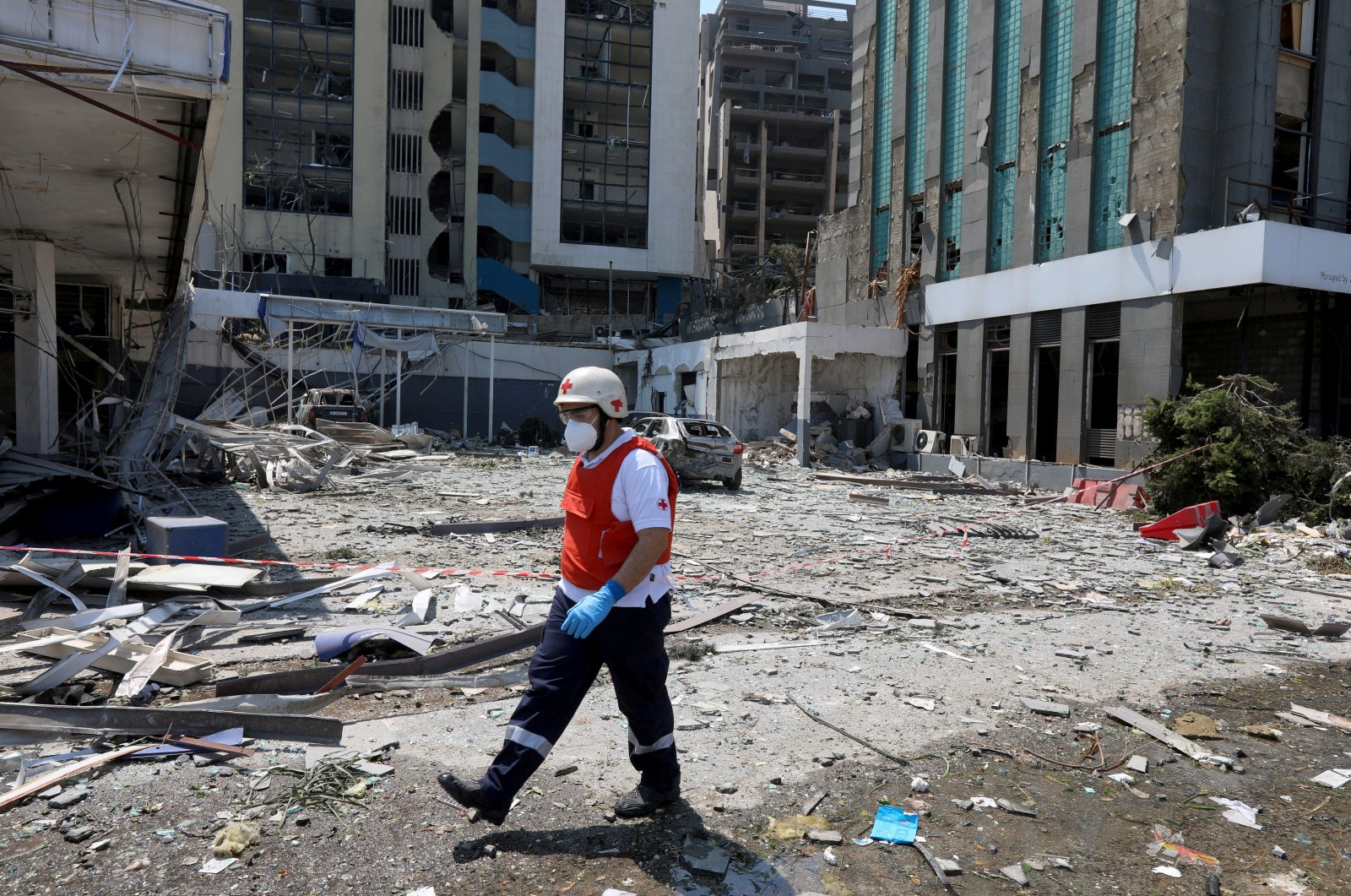 A Lebanese Red Cross member walks among the debris from damaged buildings following Tuesday's blast in Beirut's port area, Lebanon, Aug. 5, 2020. (Reuters Photo)