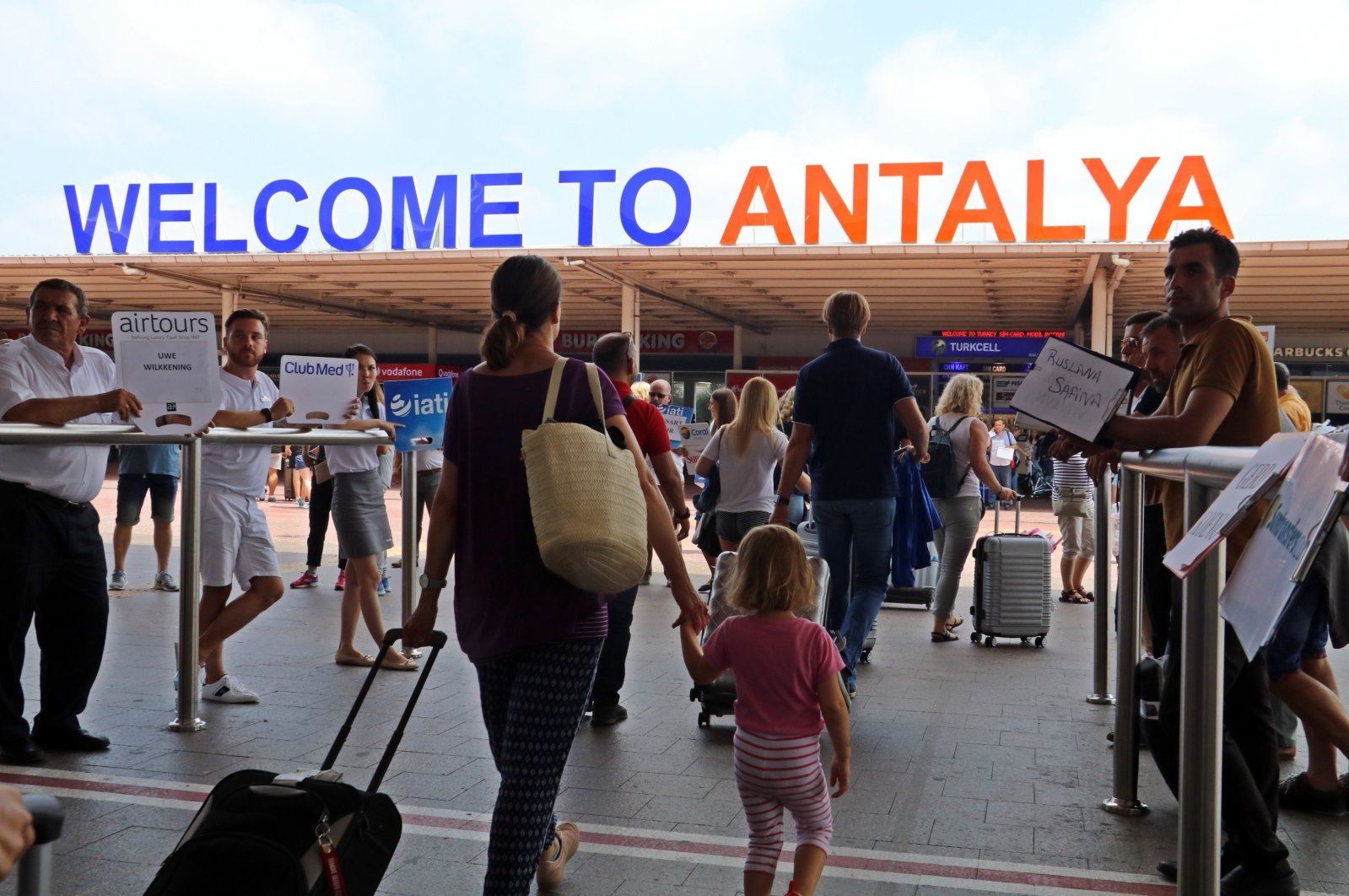 Tourists arrive at Antalya Airport, southern Turkey, Aug. 5, 2020. (IHA Photo)