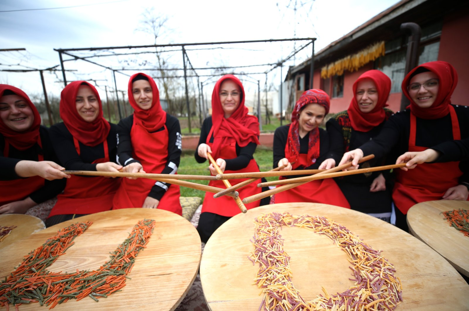 A group of women pose with food they produce in their cooperative in Düzce province, northwestern Turkey, March 8, 2020. (AA Photo)