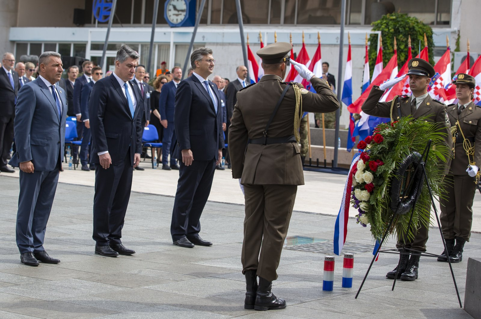 Ret. Gen. Ante Gotovina (L), Croatian President Zoran Milanovic (2nd from L) and Prime Minister Andrej Plenkovic (C) attend a ceremony in Knin, Croatia, Aug. 5, 2020. (AP Photo)