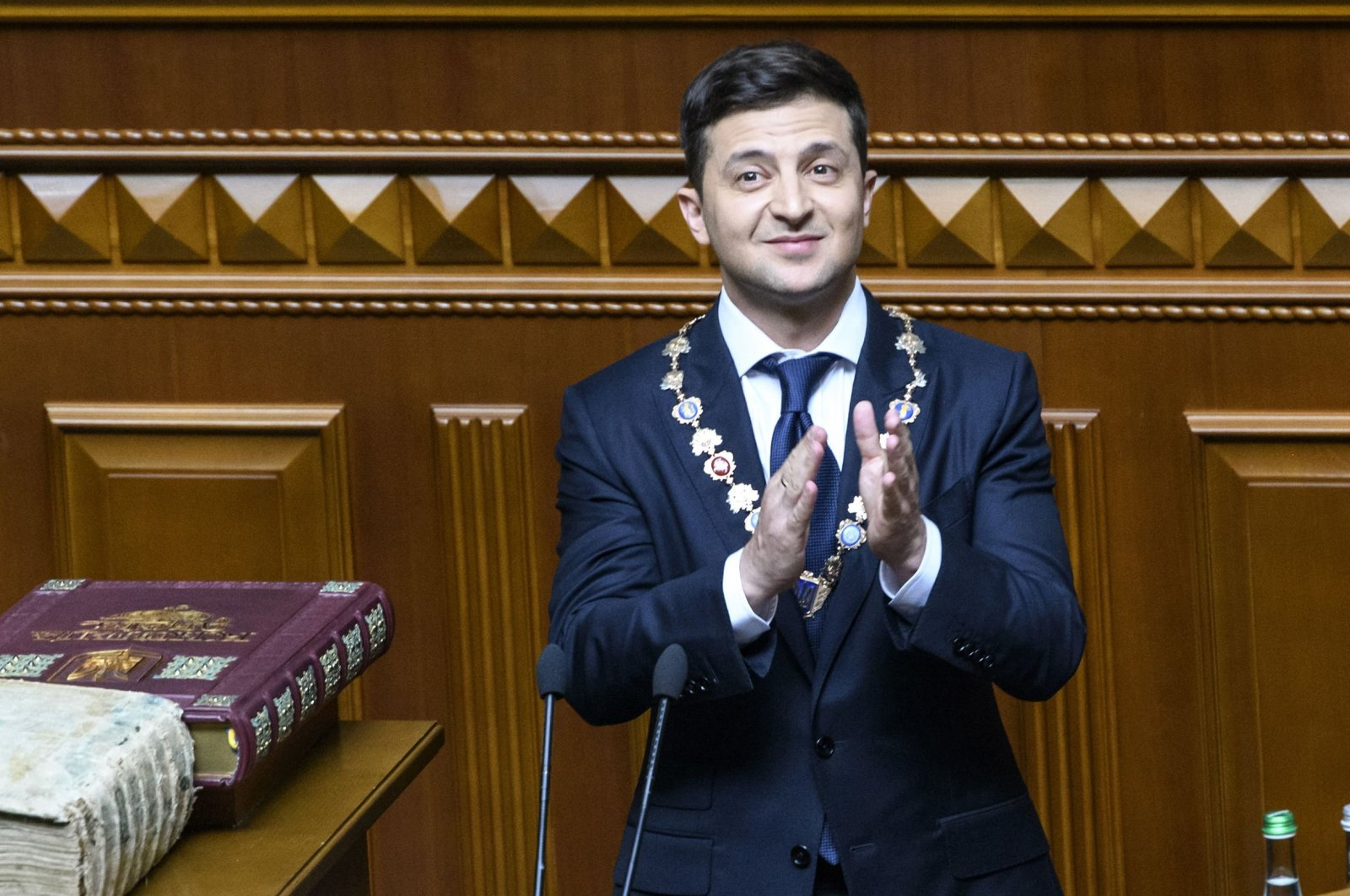 Ukraine's President Volodymyr Zelenskiy applauds during his inauguration ceremony at the parliament in Kyiv, Ukraine, May 20, 2019. (Ukrainian Prime Minister Press-Service Photo via AFP)