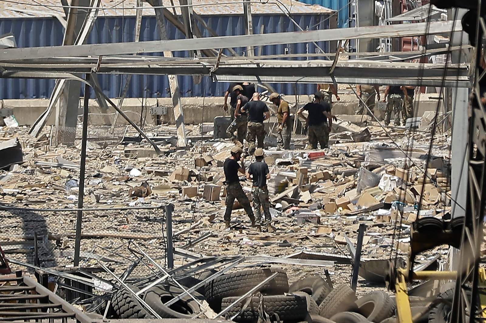 Rescuers and civil defense search through the debris at Beirut port's silo, Aug.5, 2020. (AFP Photo)