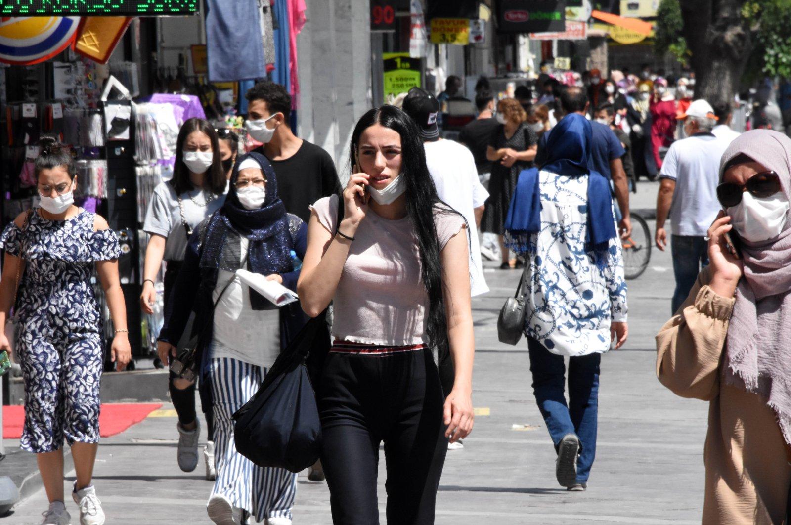 People walking on the street of Turkey's Konya province, Aug 04, 2020 (DHA Photo)