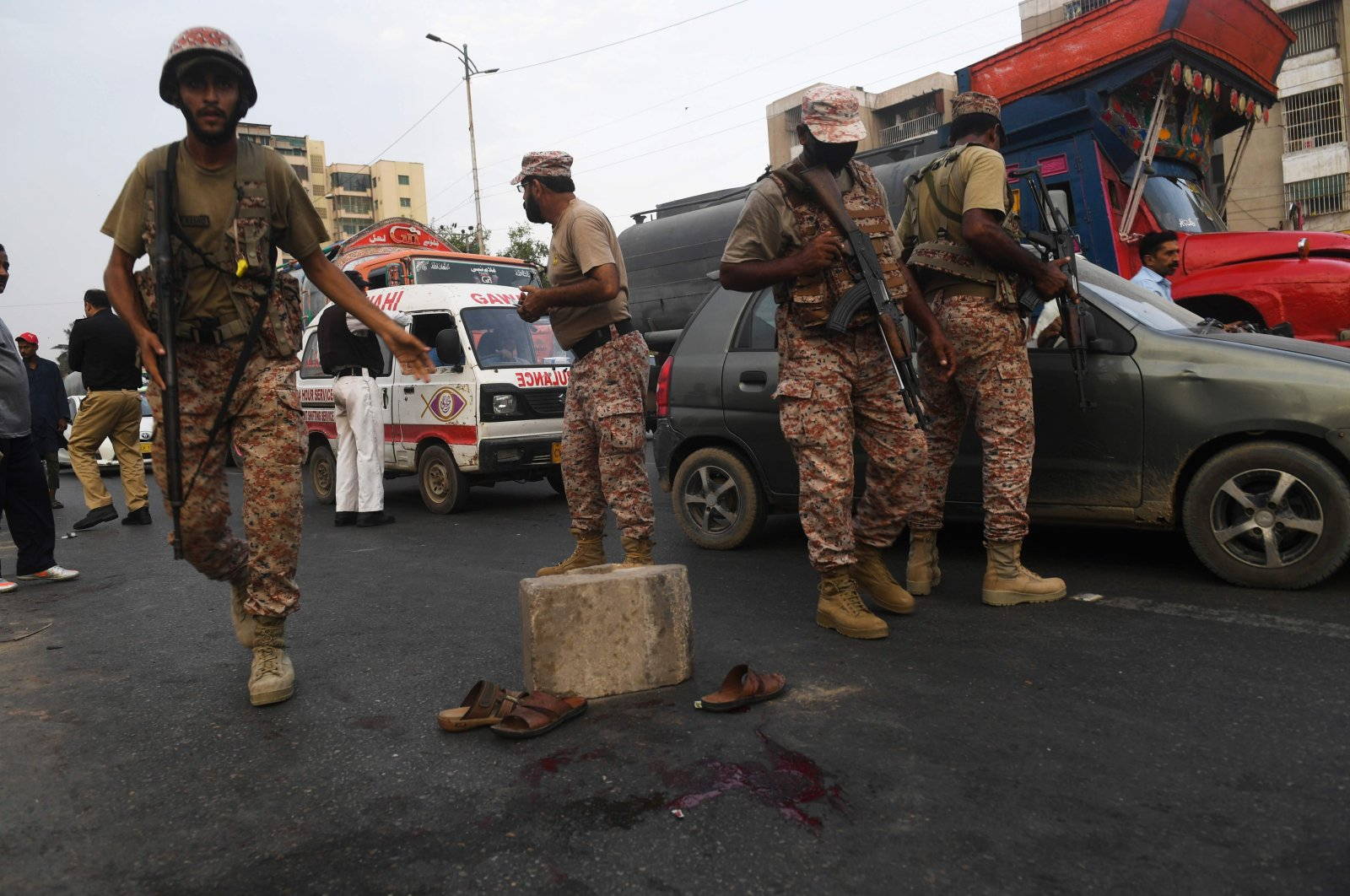 Paramilitary soldiers cordon off a the after an unidentified man threw a cracker during a rally, Karachi, Aug. 5, 2020. (AFP Photo)