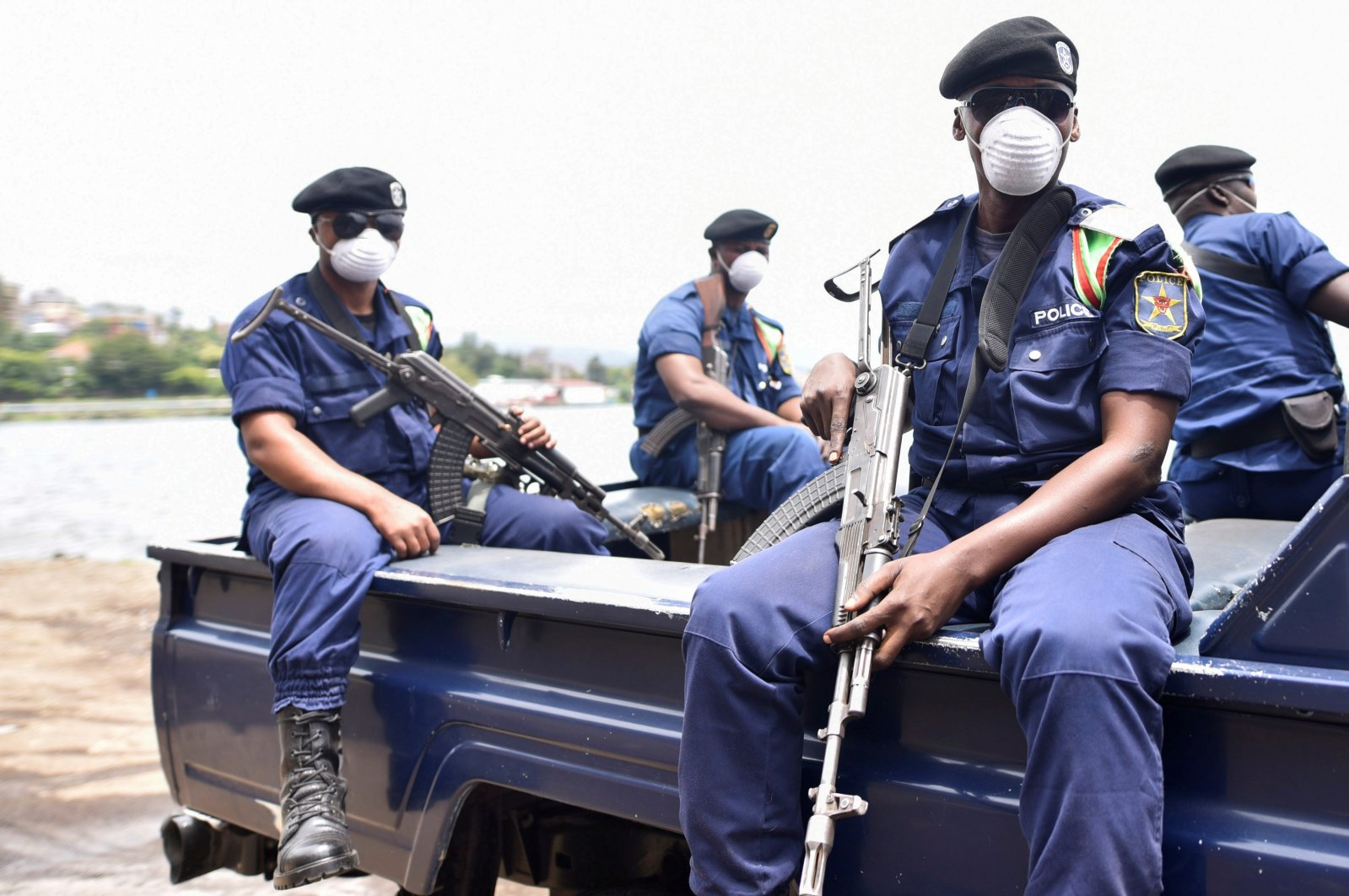 Congolese policemen wear masks as they ride on their patrol pick-up truck amid the coronavirus outbreak in Goma, eastern Democratic Republic of Congo, March 19, 2020. (Reuters Photo)