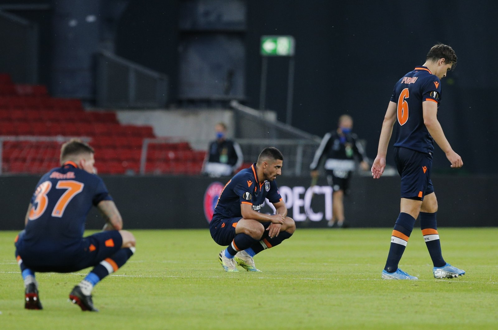 Başakşehir players linger on the field after the match with Copenhagen in the Danish capital, Aug 5, 2020. (AA Photo)