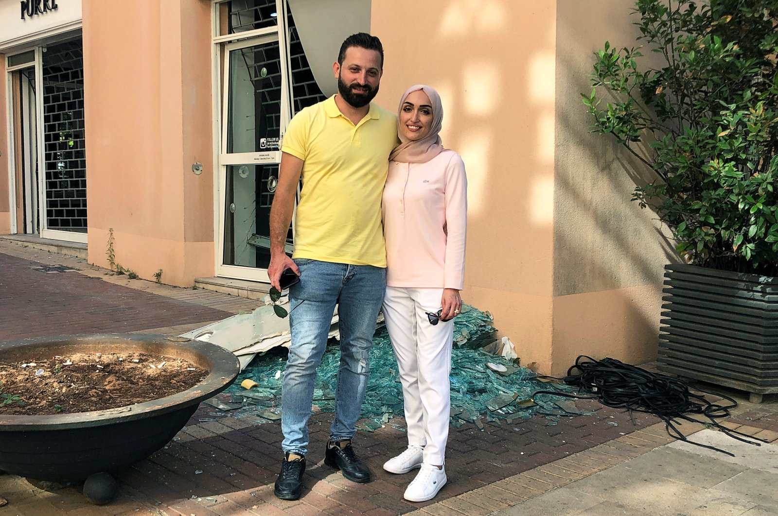 Bride Israa Seblani poses for a picture with her husband Ahmad Subeih in the same place where they were taking their wedding photos at the moment of the explosion at Beirut's port area, Aug. 5, 2020. (REUTERS Photo)