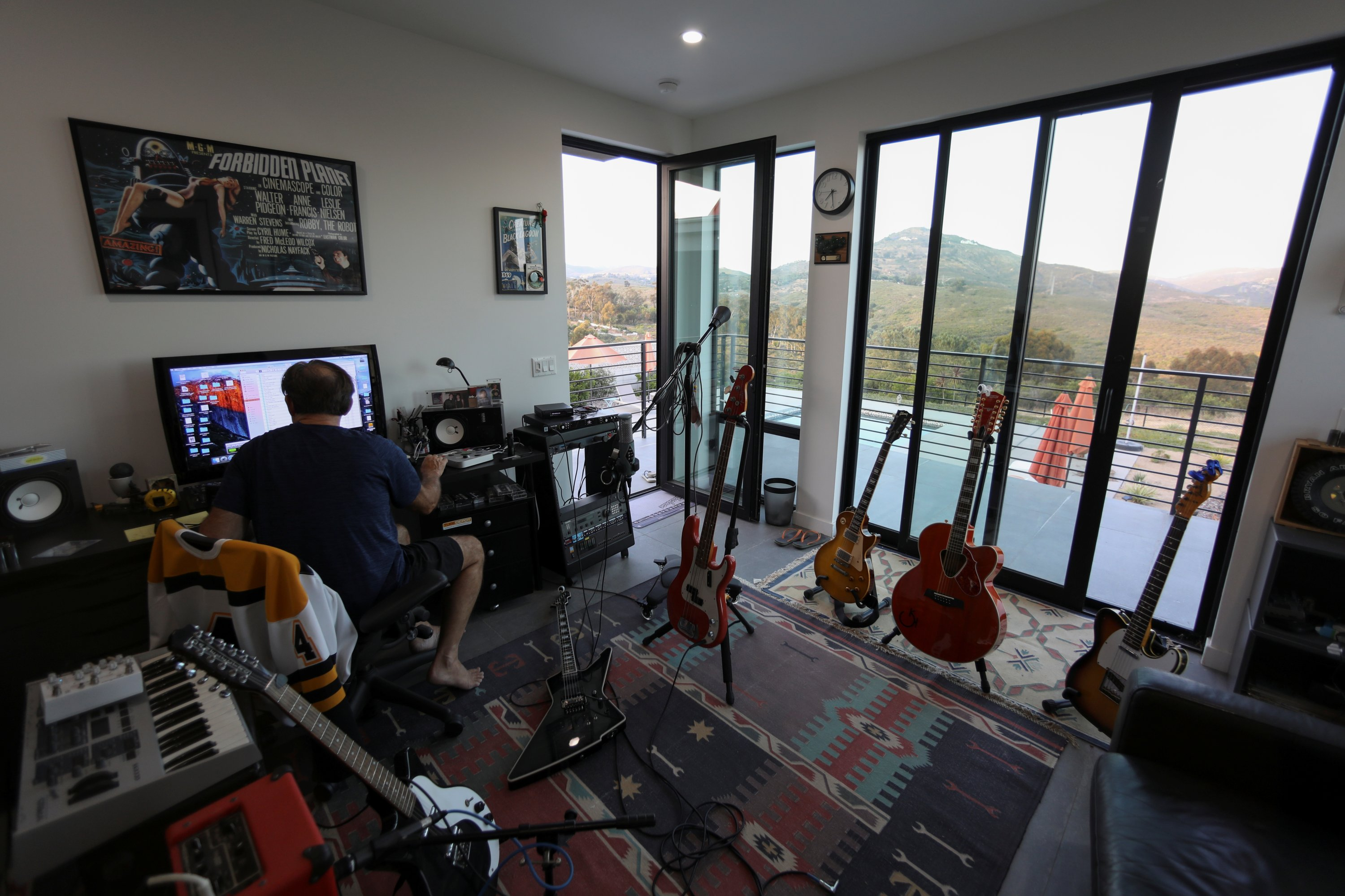 Guitarist Keith Scott, who would normally be out on tour with Bryan Adams, works on a song from his home studio during the outbreak of the coronavirus in Encinitas, California, U.S., June 16, 2020. (Reuters Photo)