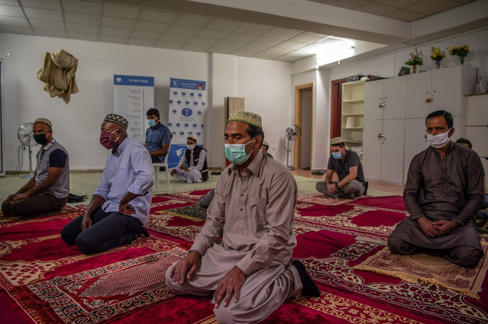 Muslims wear protective face masks as they pray at a mosque in Athens, Greece, July 31, 2020. (AFP Photo)