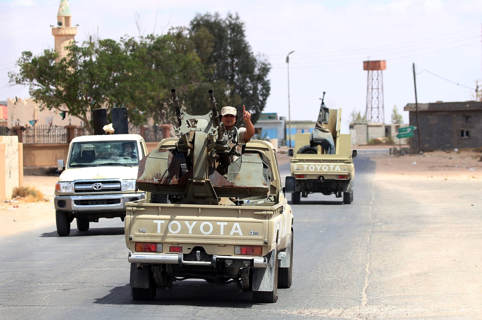 Fighters loyal to the internationally recognized Libyan Government of National Accord (GNA) secure the area of Abu Qurain, halfway between the capital Tripoli and Libya's second-largest city Benghazi, against forces loyal to putschist Gen. Khalifa Haftar, who is based in eastern Benghazi, in Libya, July 20, 2020. (AFP Photo)