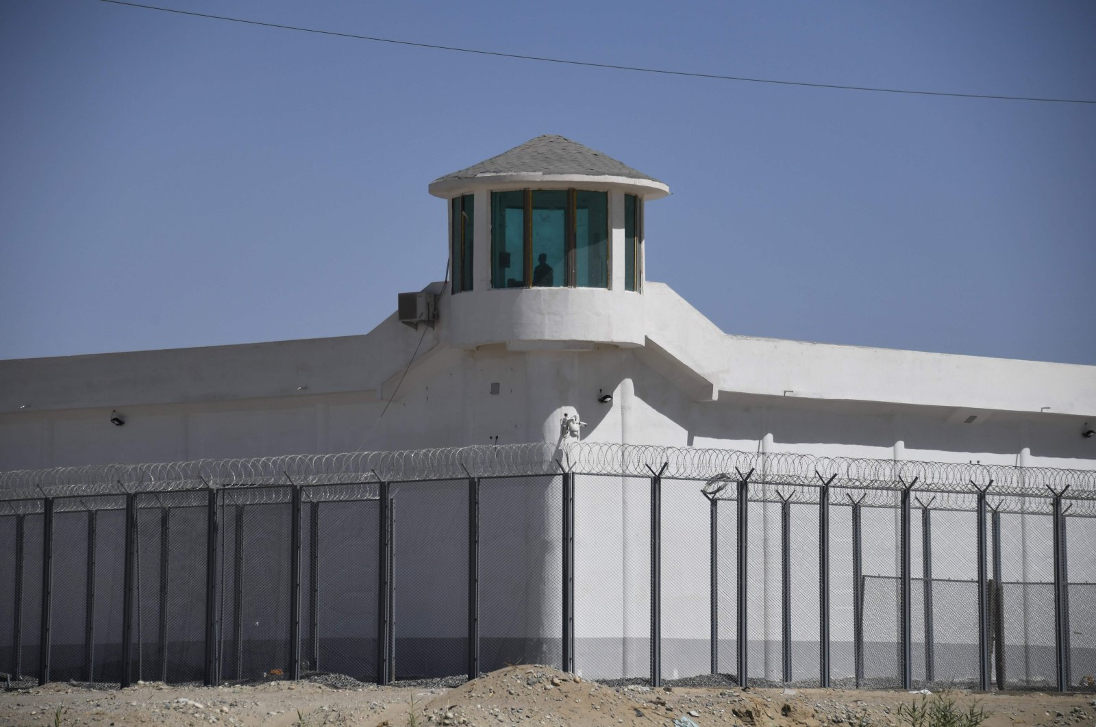 A watchtower on a high-security facility near what is believed to be a re-education camp where mostly Muslim ethnic minorities are detained, on the outskirts of Hotan, in China's northwestern Xinjiang region, May 31, 2019. (AFP Photo / Badung Police)