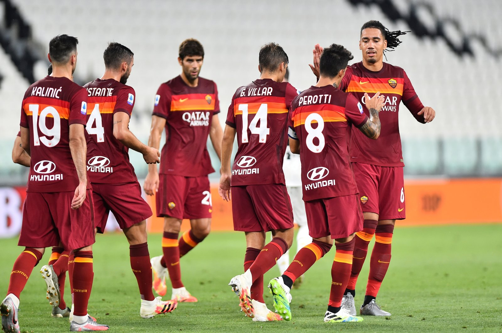 AS Roma players celebrate a goal during a Serie A match against Juventus in Turin, Italy, Aug. 1, 2020. (Reuters Photo)