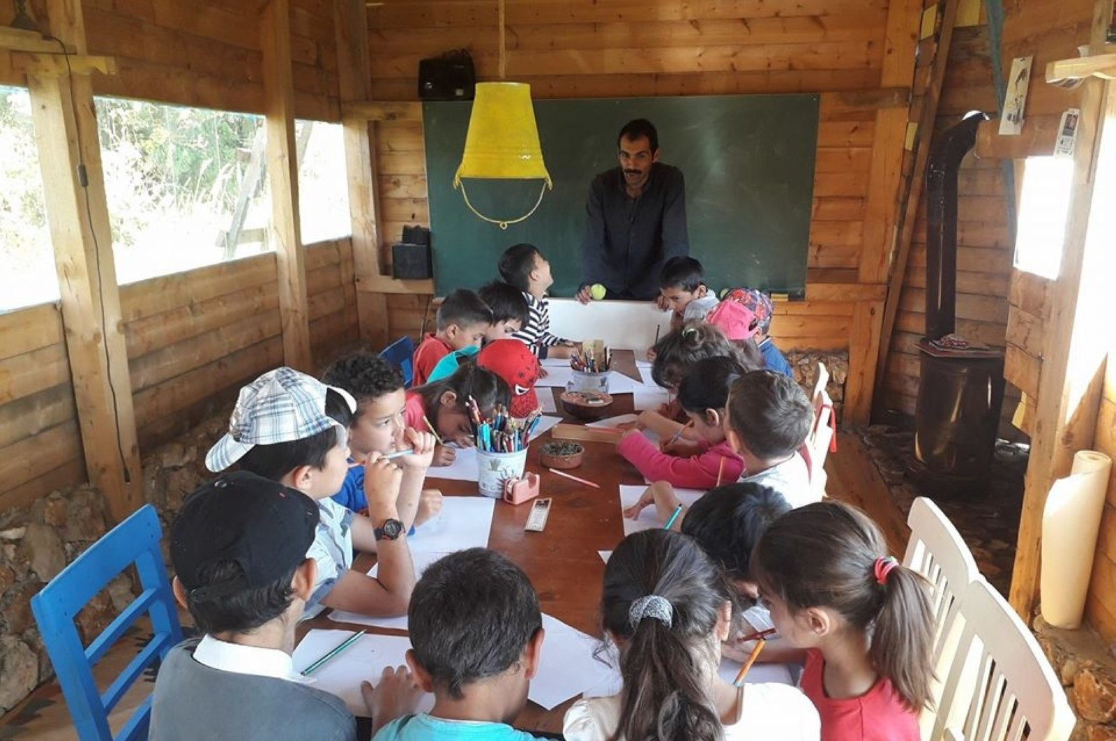 Fatih Küçük in a lesson with children at The Cartoon Mill.