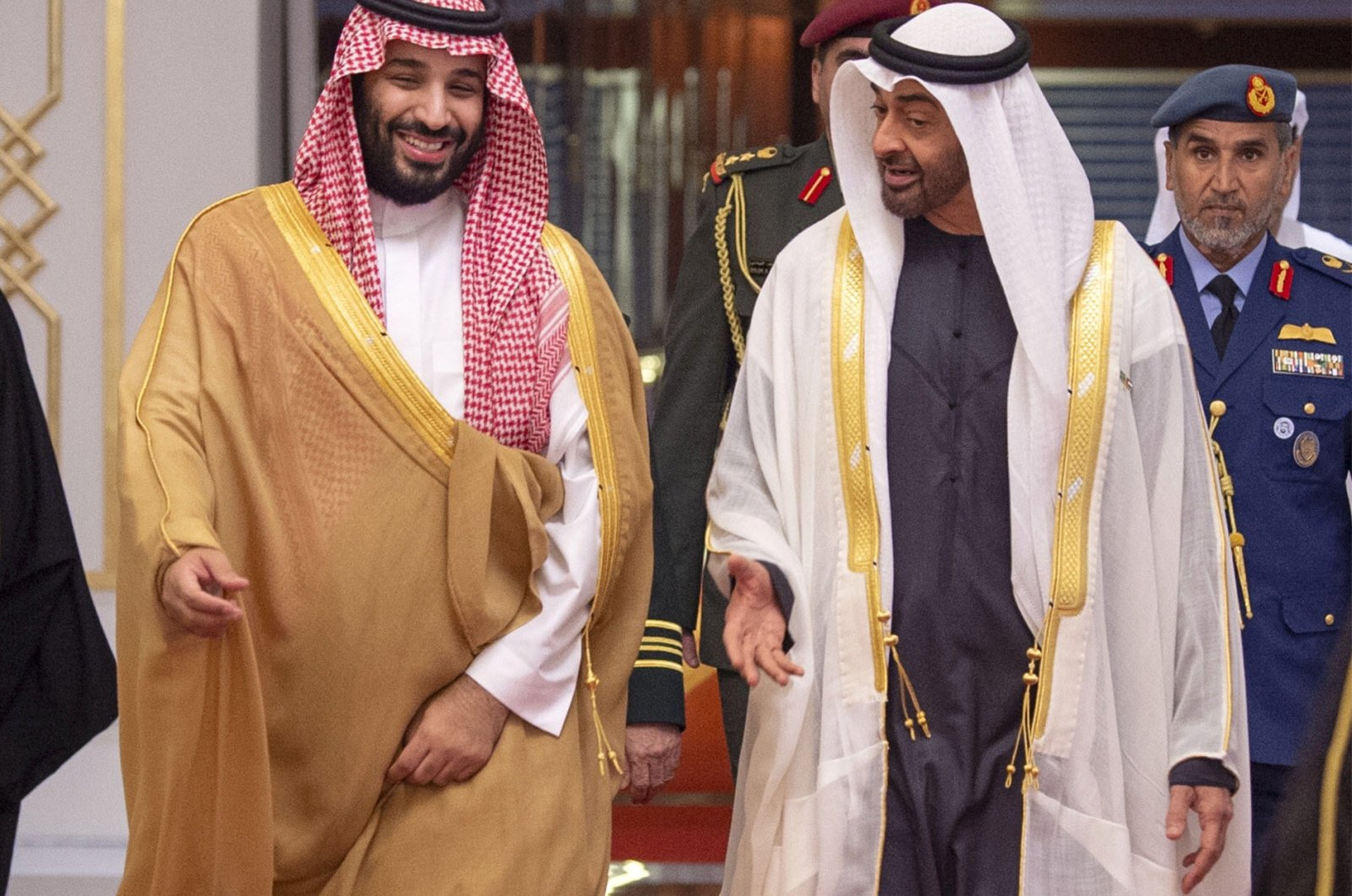 A handout picture provided by the Saudi Royal Palace shows Saudi Crown Prince Mohammed bin Salman (L) being received by Abu Dhabi's Crown Prince and Deputy Supreme Commander of the UAE Armed Forces, Sheikh Mohamed bin Zayed Al Nahyan, Abu Dhabi, Nov. 22, 2018. (AFP Photo)