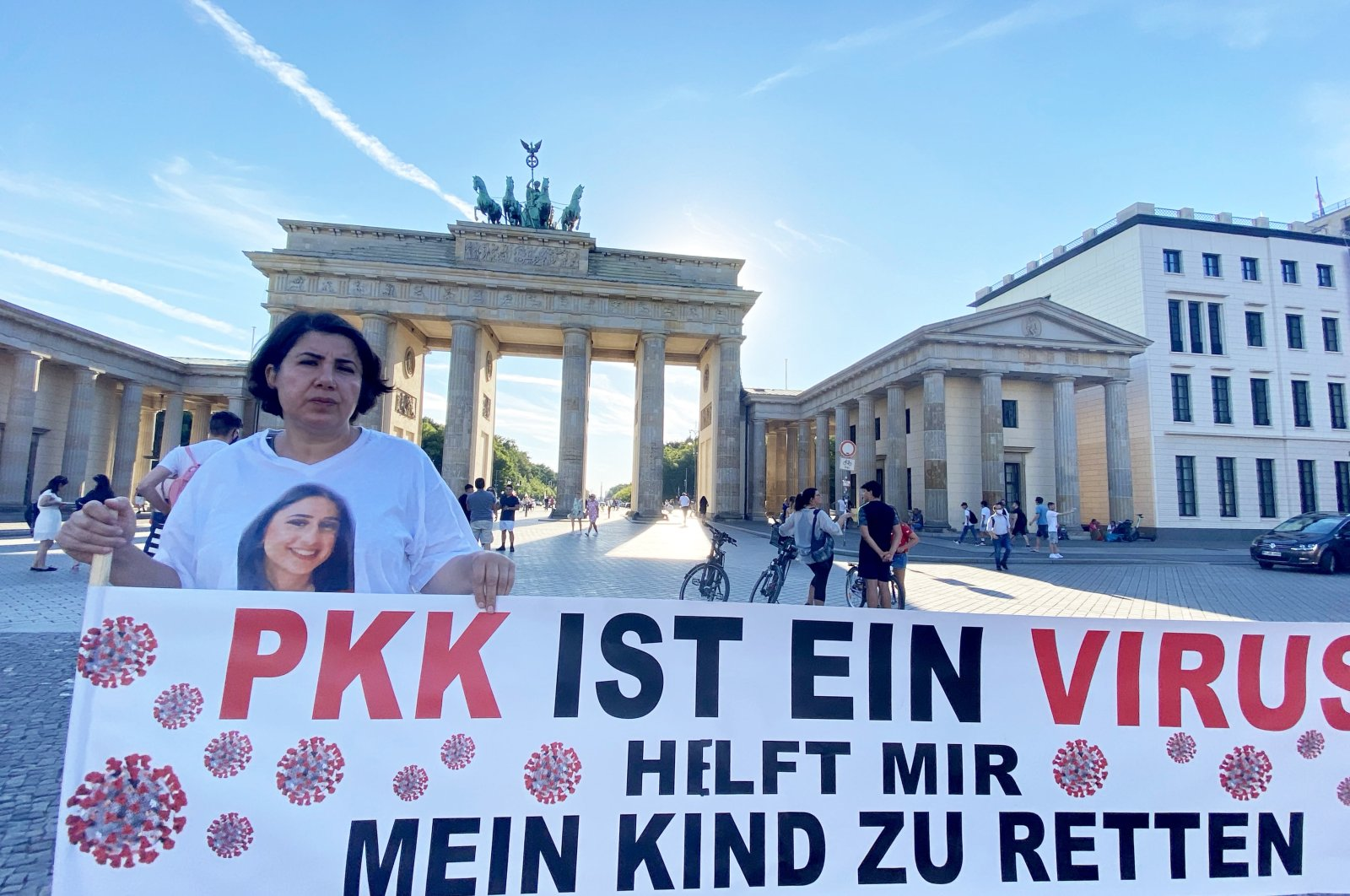 Turkish-German mother Maide T. continues her protest in front of Brandenburg Gate to demand the return of her daughter who was forcibly recruited by the PKK terrorist group in Berlin, Germany on Aug. 5, 2020. (AA Photo)