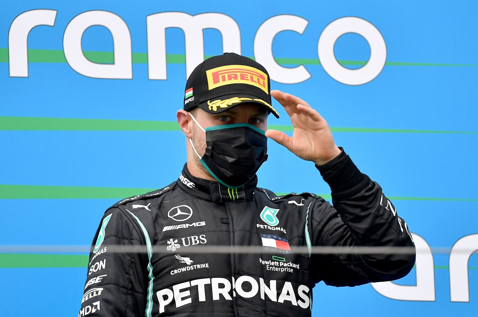 Mercedes driver Valtteri Bottas gestures on the podium after the Formula 1 Hungarian Grand Prix race in Mogyorod, Hungary, July 19, 2020. (AFP Photo)