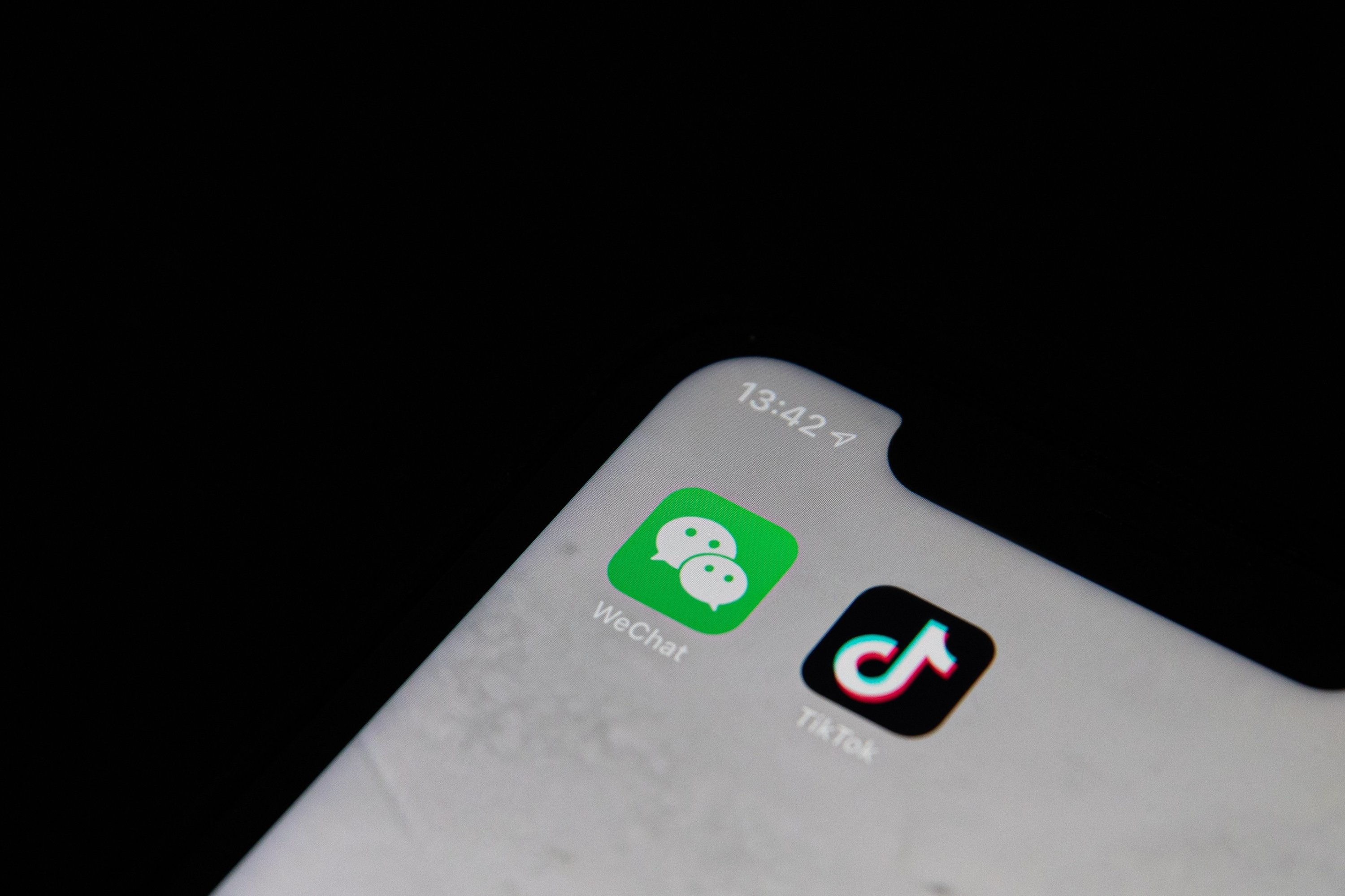 Trump bans dealings with Chinese owners of TikTok, WeChat | Daily ...