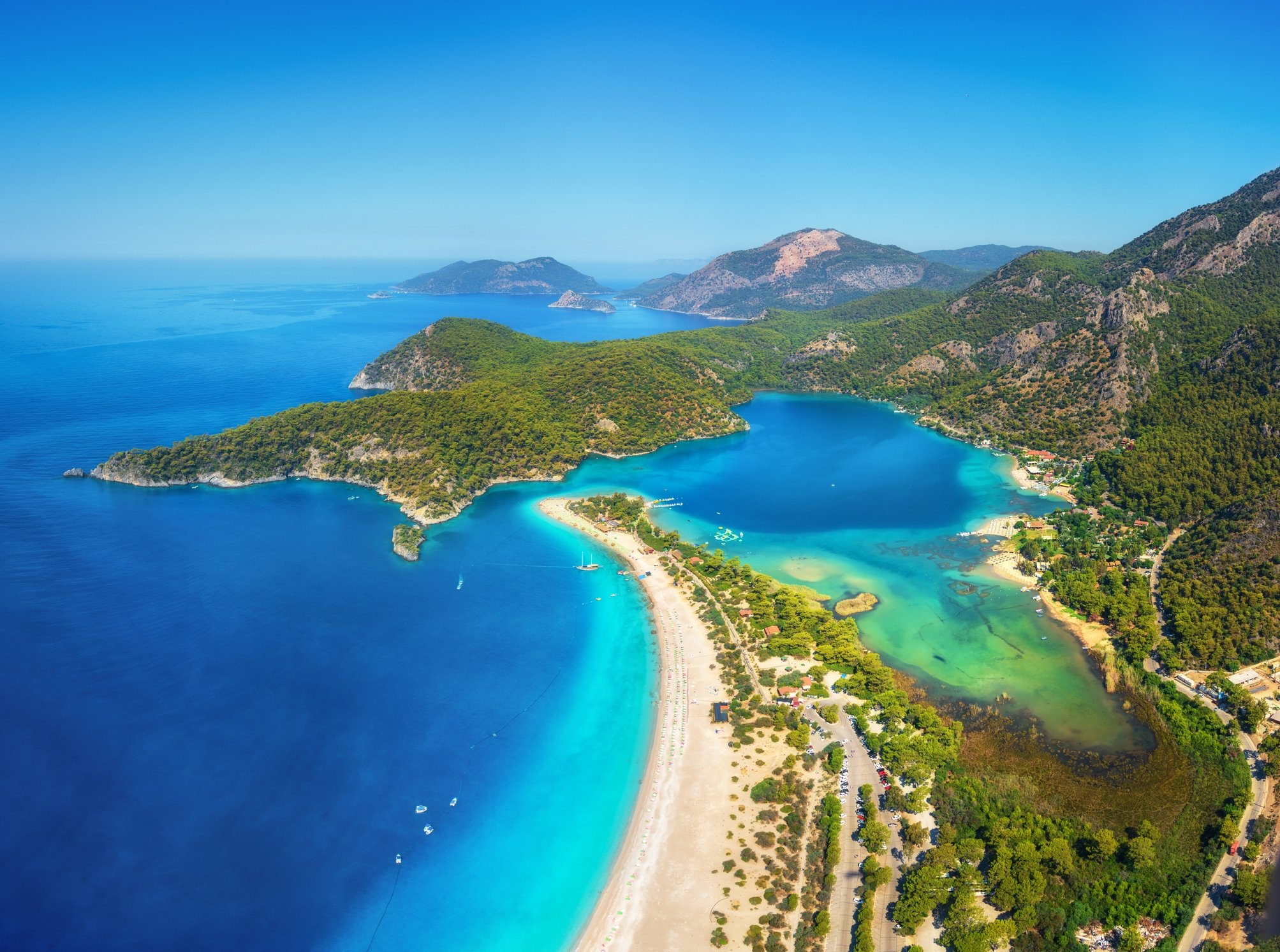 Ölüdeniz Beach is a great combination of majestic mountains, green forests, azure waters and sandy beached. (iStock Photo)