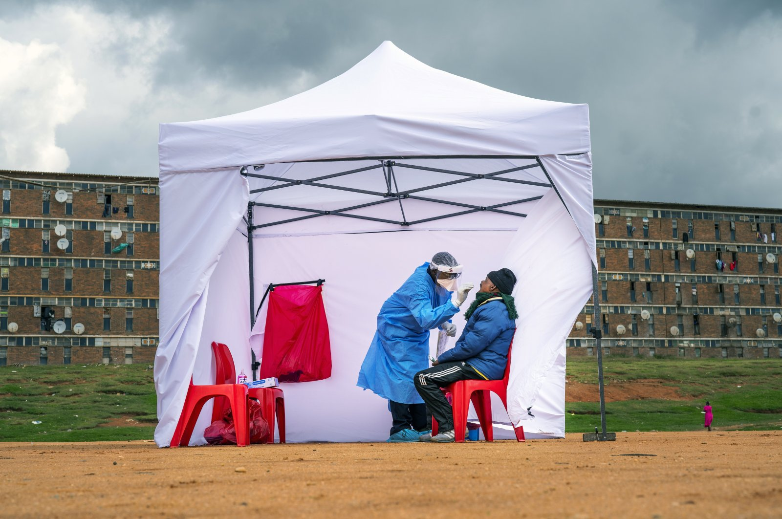 In this April 29, 2020, file photo, a resident from the Alexandra township gets tested for COVID-19, in Johannesburg, South Africa. Africa's confirmed coronavirus cases have surpassed 1 million, but global health experts tell The Associated Press the true toll is several times higher.  (AP Photo)