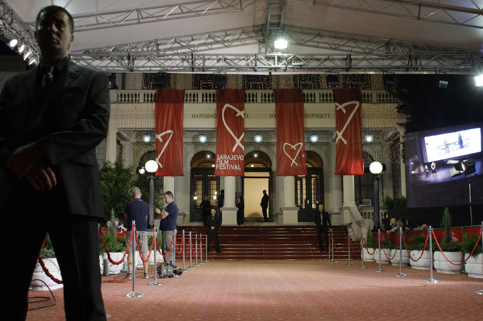A security guard secures the entrance to the Bosnian National Theatre during the opening ceremony of the 17th Sarajevo Film Festval in Bosnian capital Sarajevo, July 22, 2011. (AP PHOTO)