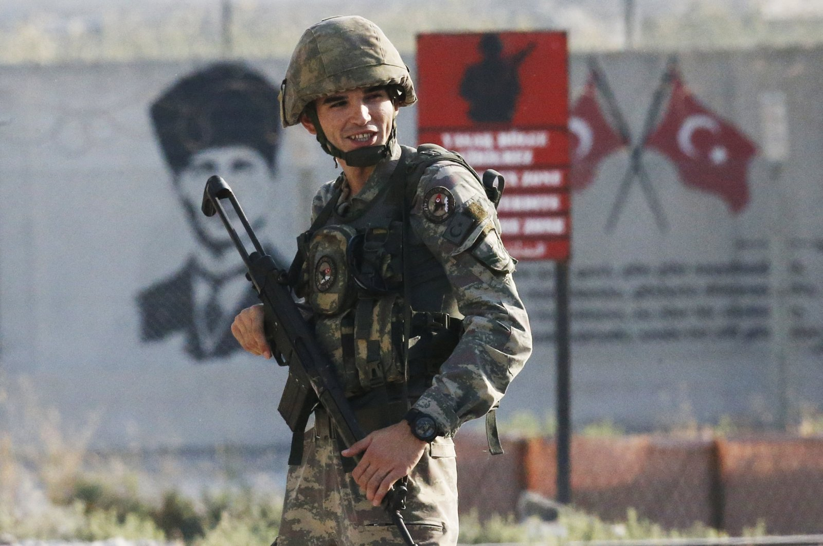 Shortly after the Turkey's Operation Peace Spring operation inside Syria had started, a Turkish soldier stands at the border with Syria in Akçakale, Şanlıurfa province, Oct. 9, 2019. (AP Photo)