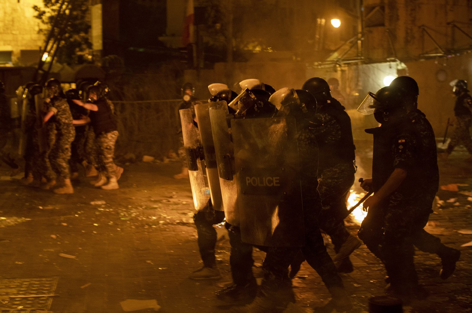 Riot police advance to push back anti-government protesters, Beirut, Aug. 7, 2020. (AP Photo)