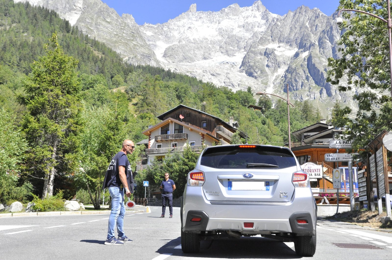 Residents and tourists who occupy about 30 houses in the lower part of the Val Ferret (Courmayeur) began evacuating this morning due to the alert for the collapse of a part of the Planpincieux glacier in Aosta Valley region, northwestern Italy, Aug. 6, 2020. (EPA Photo)