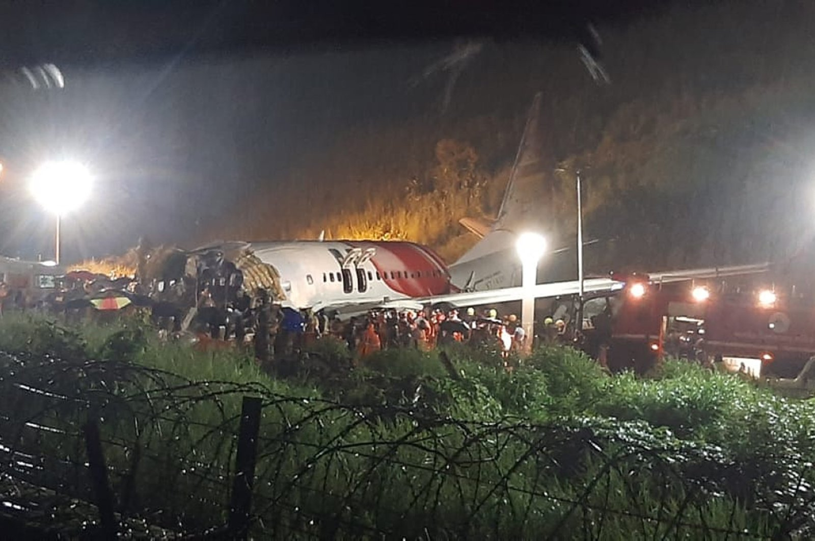 The Air India Express flight that skidded off a runway while landing at the airport in Kozhikode, Kerala state, India, Aug. 7, 2020. (AP Photo)