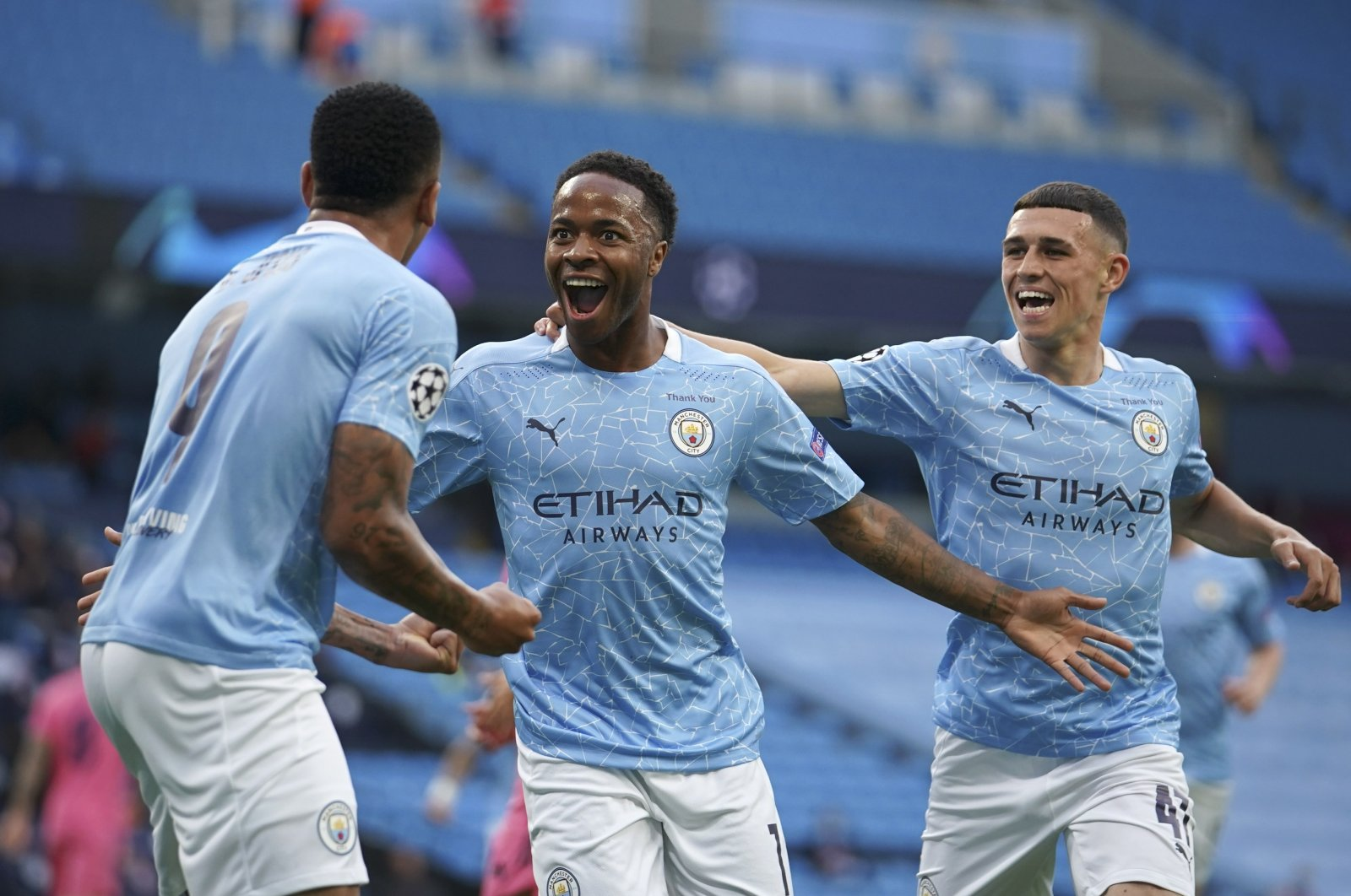 Manchester City's Raheem Sterling, center, celebrates after scoring the opening goal during the Champions League round of 16, second leg football match between Manchester City and Real Madrid at the Etihad Stadium stadium in Manchester, England, Friday, Aug. 7, 2020. (AP Photo)